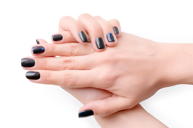 Woman Hands With Black Manicure