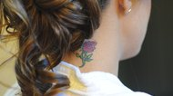 Woman with a flower neck tattoo