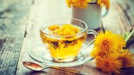 Cup of healthy dandelion tea. Herbal medicine. Retro toned.