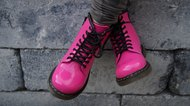 Pink punk alternative girl or woman shoes - cross legged