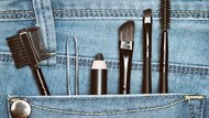 Eyebrow grooming tools in jeans pocket