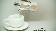 Coffee Percolator pouring coffee into cup