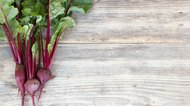 Fresh organic beet on a wood table with copy space