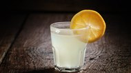 Single glass of vodka with lemon and lemon slice
