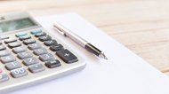 Calculator and notebook with pen