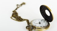 Pocket watch against a light background