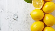 fresh ripe lemons on wooden table