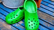 Croc sandals on a wooden deck