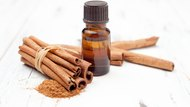 ground cinnamon, essential oil and cinnamon sticks cinnamon on a