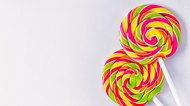 Spiral lollipops on white background