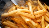 French Fries In The Deep Fryer
