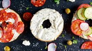 Delicious Bagel sandwiches with soft cheese, chorizo and vegetables