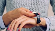 Female hands dress watch on wrist