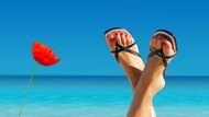 feet crossed on an island paradise