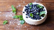 blueberry cheesecake on a wooden background