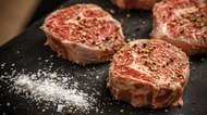 Raw meat steaks