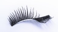 one bent false eyelash