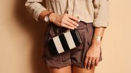 Fashionable woman with  stylish black and white clutch