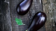 Fresh aubergine on vintage wood background