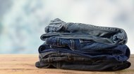 Stack of jeans on wooden.