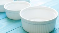 White Ramekin bowl on blue wooden board