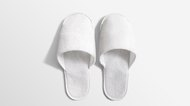 Pair of blank soft white home slippers, design mockup