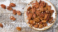 Pecan nuts on a wooden table.