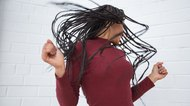 Woman Shaking Head With Dreadlocks