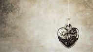 Heart pendant on grunge background