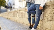 How to Make Ripped Jeans With a Knife and Scissors