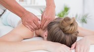 Therapist massaging a patient