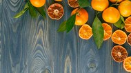 Background from dried oranges on a wooden floor.