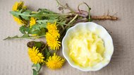 Dandelion flowers with homemade salve top view