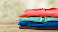 Stack of polo shirt on wooden.