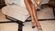 Perfect female legs wearing high heels
