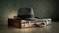 Borsalino hat and briefcase