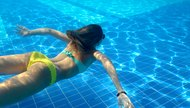Underwater shot of girl with perfect fitness body