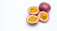 Passion fruit and half isolated on white.
