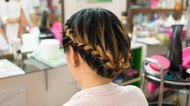 long braid creative brown hair style in salon beauty