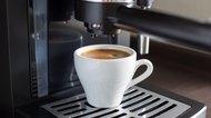 Brewing tasty espresso with coffee machine.