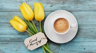 Coffee mug with yellow tulip flowers and notes good morning