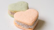 Two color alfajores cornstarch with heart shape on white backgro