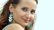 girl with blue earrings