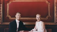 Portrait of a Smiling Ballroom Dancing Couple Sitting at a Table