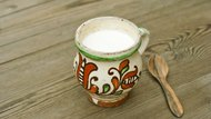Yogurt in ceramic jug