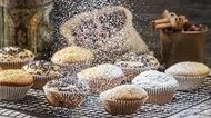 Falling powder sugar on vanilla muffins