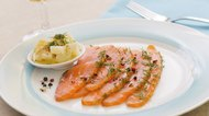 Smoked  salmon and ingredients in plate on table