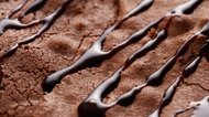 Chocolate sauce drizzled on brownie