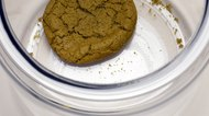 Single cookie in cookie jar, elevated view