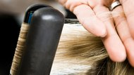Person having hair straightened